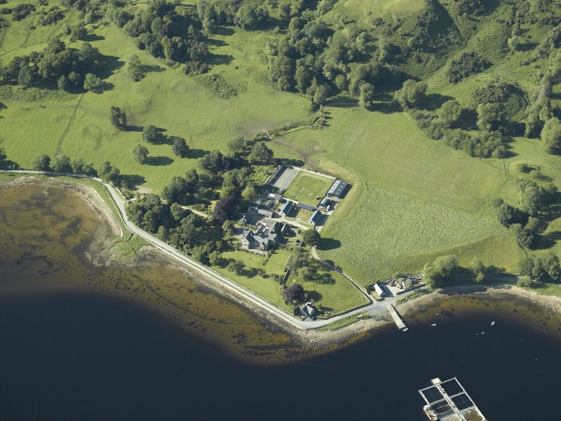 Oblique aerial view centred on the priory, house and pier, taken from the S.