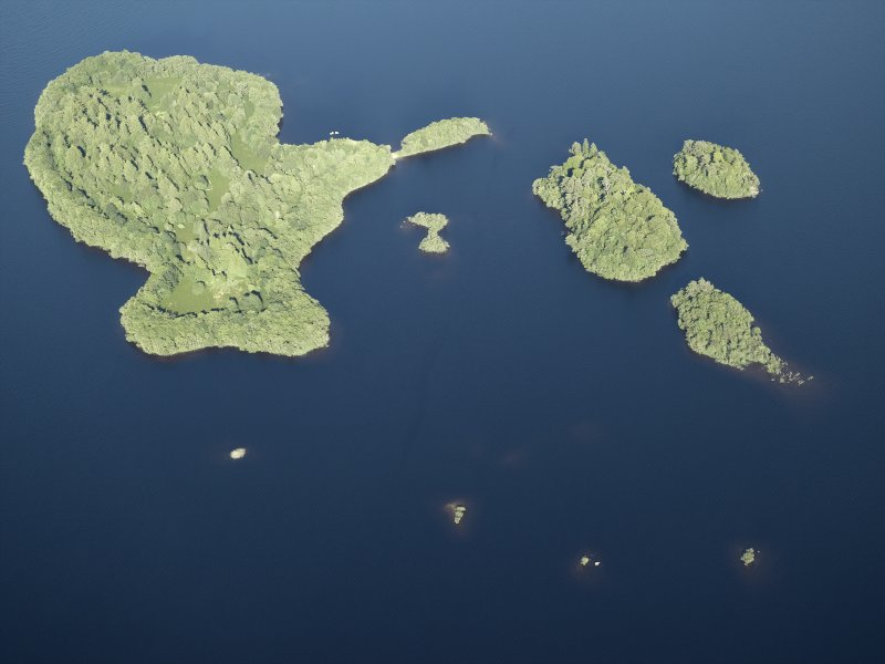 Oblique aerial view centred on the remains of the crannog and the islands, taken from the W.