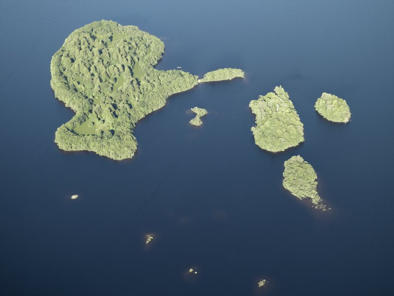 Oblique aerial view centred on the remains of the crannog and the islands, taken from the WSW.