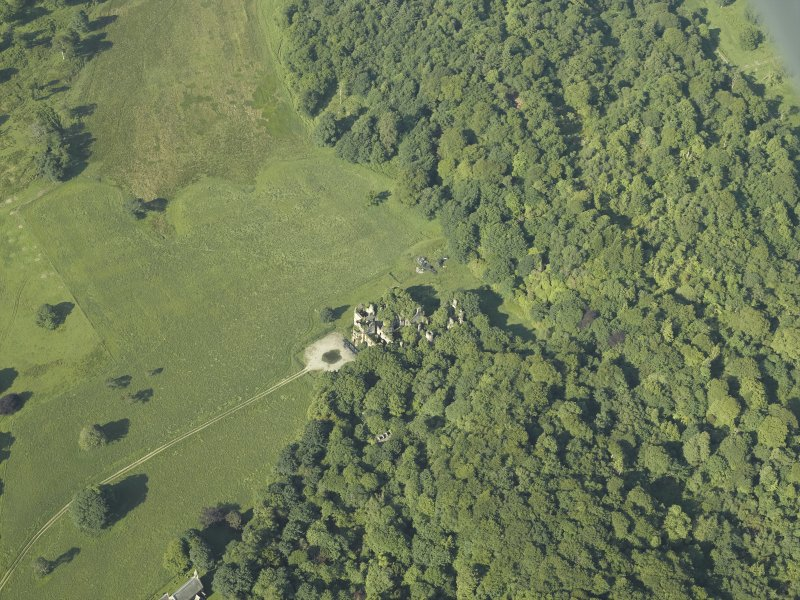 General oblique aerial view centred on ruins of the country house, taken from the NE.
