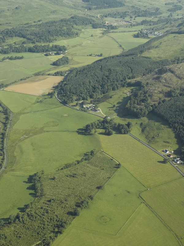 General oblique aerial view centred on the remains of the standing stones and henge, taken from the S.