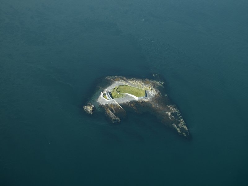 Oblique aerial view centred on Fladda lighthouse in the Firth of Lorne, taken from the NE.