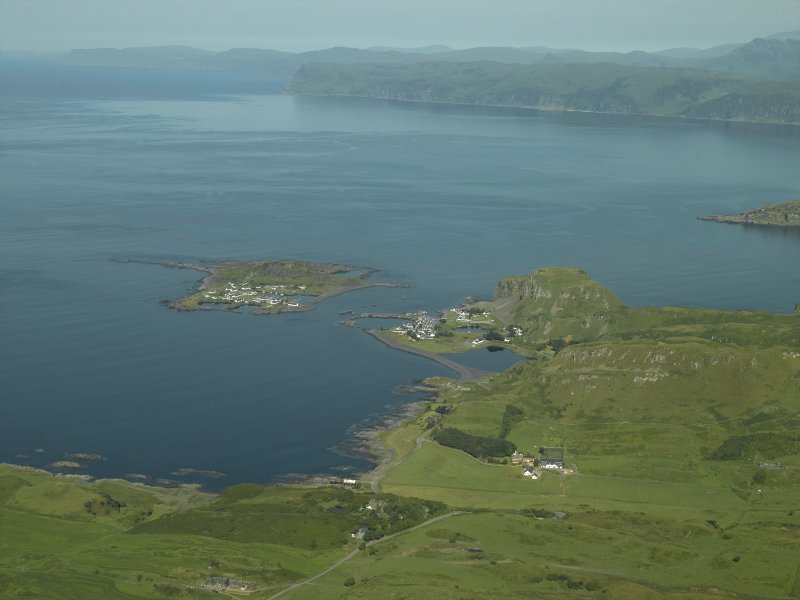 General distant oblique aerial view centred on the village and the remains of the slate quarries with the slate quarry and harbour adjacent, taken from the ESE.