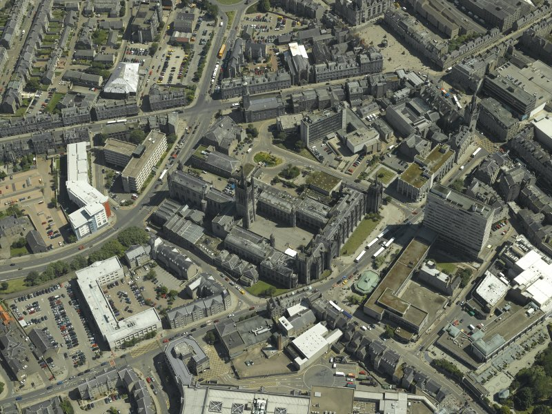 Oblique aerial view centred on the friary, colleges, hospital, churches, tolbooth and cathedral, taken from the W.