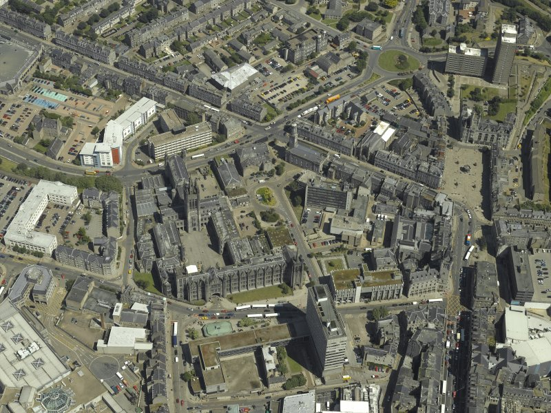 Oblique aerial view centred on the friary, colleges, hospital, churches, tolbooth and cathedral, taken from the SW.