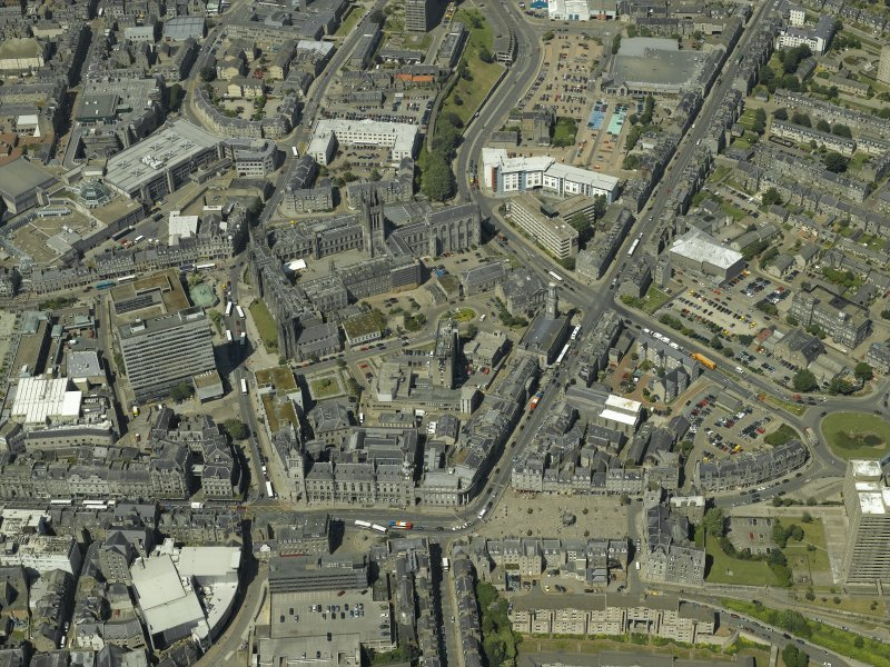 General oblique aerial view centred on the friary, colleges, hospital, churches, tolbooth and cathedral, taken from the ENE.