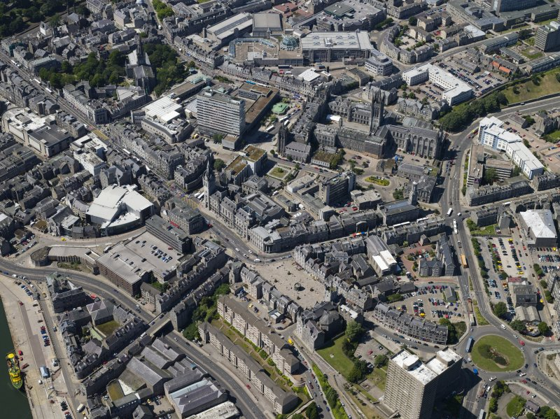 General oblique aerial view centred on the friary, colleges, hospital, churches, tolbooth and cathedral, taken from the E.