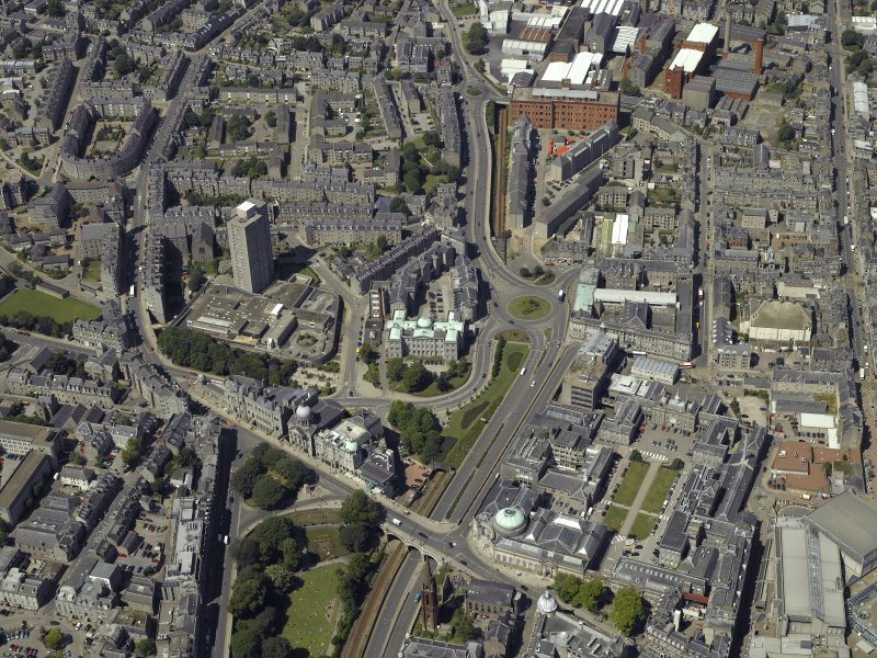 General oblique aerial view centred on the hospital and theatre with the school, museum, art gallery and churches adjacent, taken from the SE.