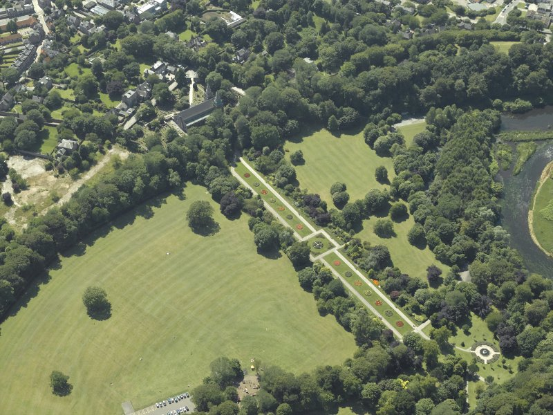 Oblique aerial view centred on the cathedral, burial ground and park, taken from the NE.