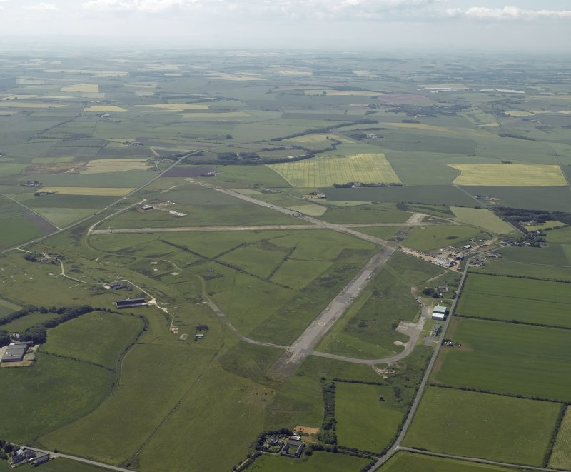 General oblique aerial view centred on the airfield, taken from the ENE.