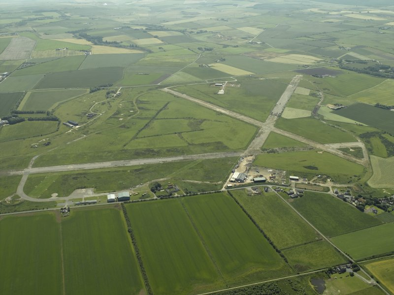 General oblique aerial view centred on the airfield, taken from the NNE.
