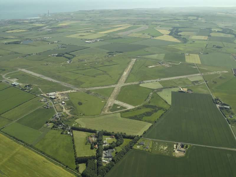 General oblique aerial view centred on the airfield, taken from the NW.