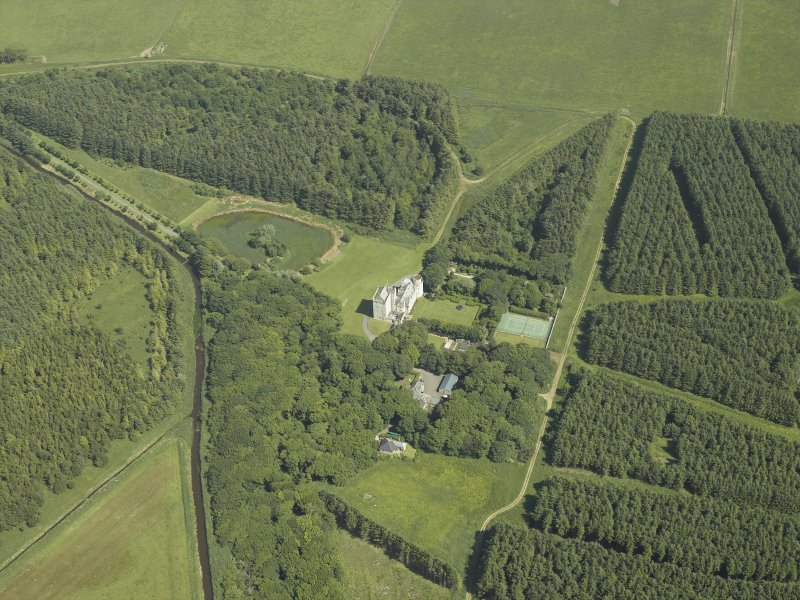 Oblique aerial view centred on the tower-house and walled garden, taken from the W.