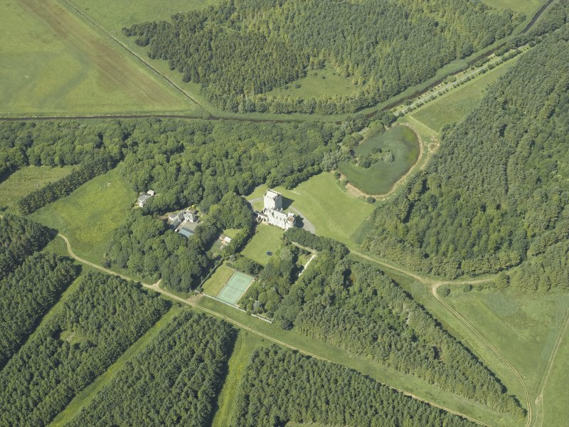 Oblique aerial view centred on the tower-house and walled garden, taken from the SE.
