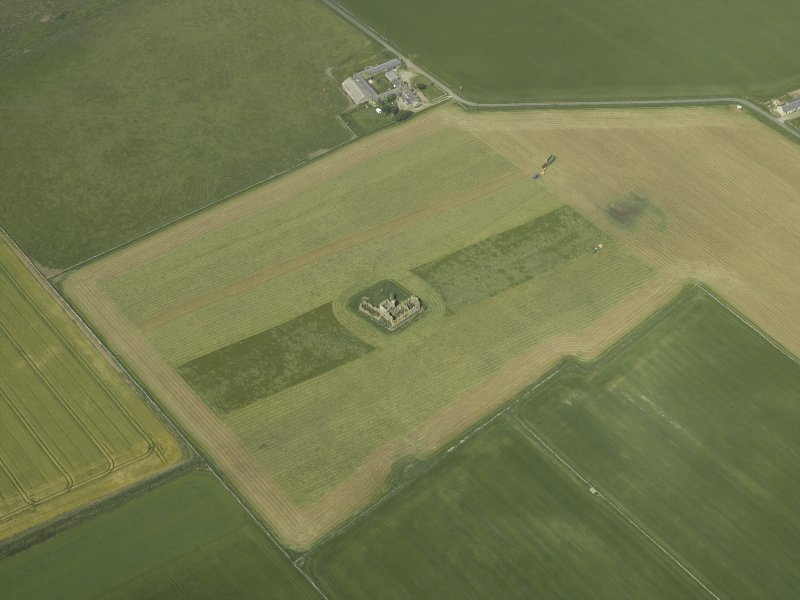 Oblique aerial view centred on the remains of the castle, taken from the SSW.