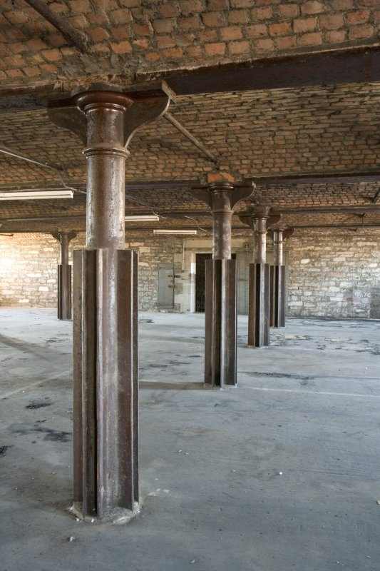 Interior. 3rd floor. View of cast-iron columns, beams and brick arched structure.