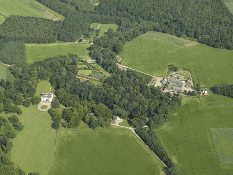 General oblique aerial view centred on the castle, tower-house, walled garden and farmsteading, taken from the W.