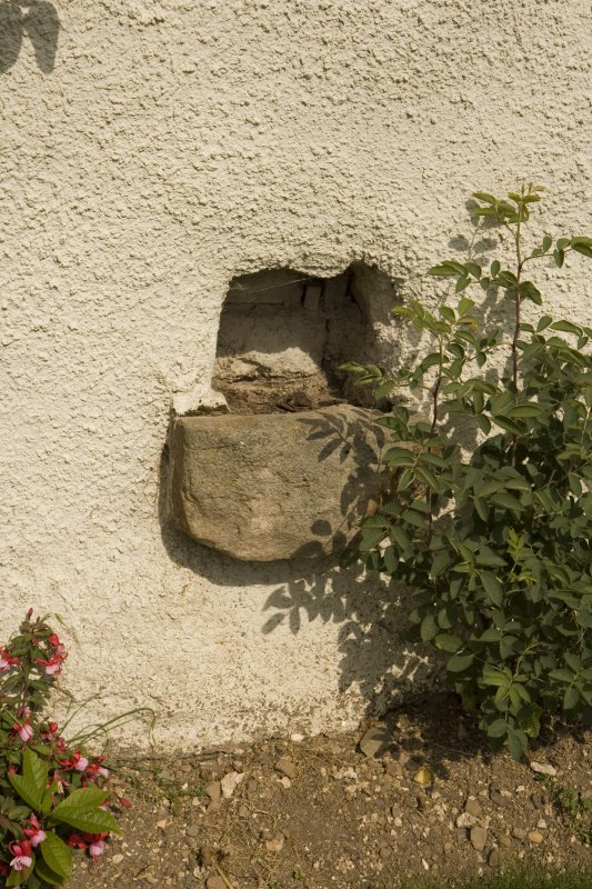Detail of stone trough set into wall at ground floor level of S facade