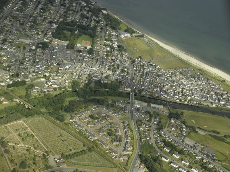 Oblique aerial view of the town centred on the road bridge, railway viaduct and cemetery, taken from the ESE.