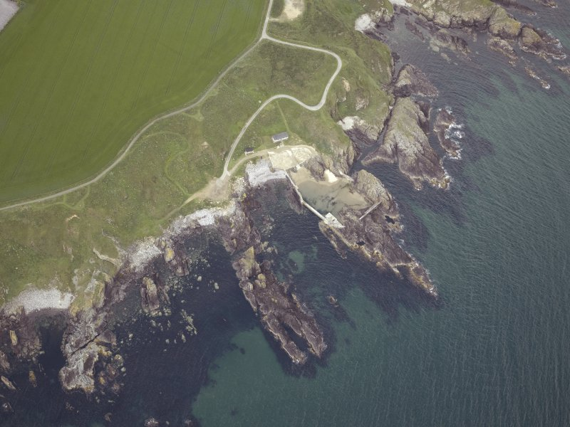 Oblique aerial view centred on Portsoy swimming pool, taken from the NE.