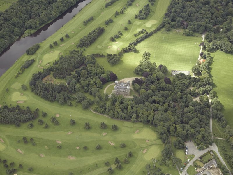 Oblique aerial view centred on the country house and golf course, taken from the NNE.