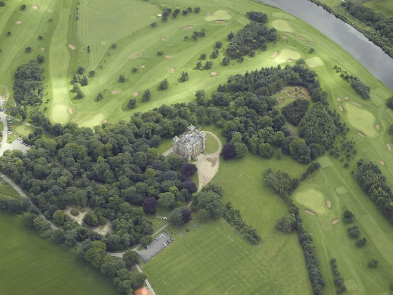 Oblique aerial view centred on the country house and golf course, taken from the WSW.