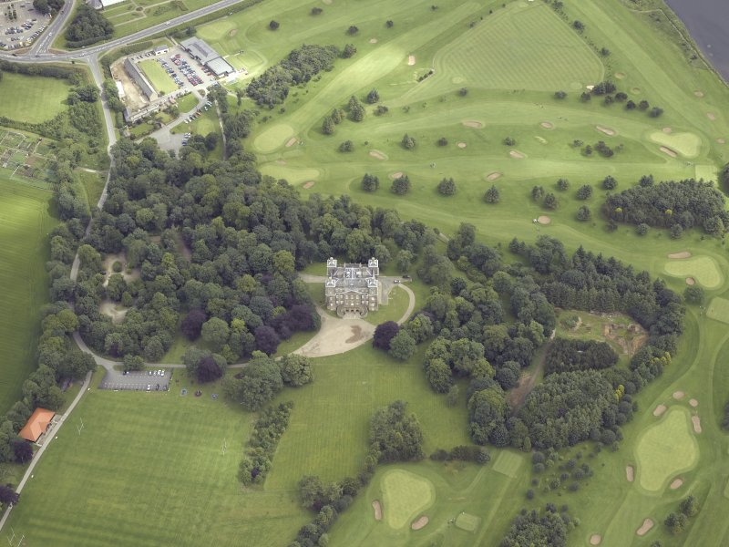 Oblique aerial view centred on the country house and golf course, taken from the S.