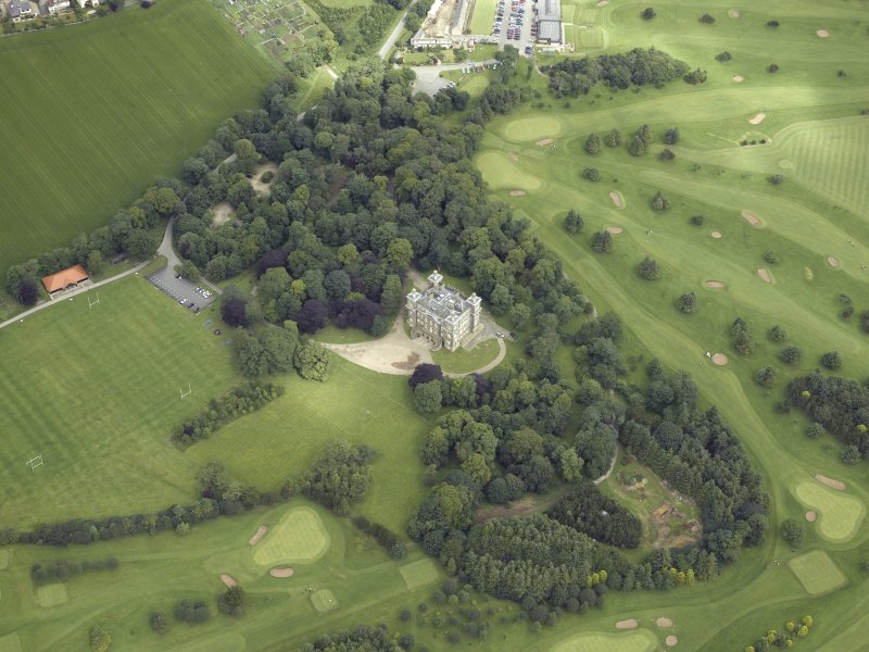 Oblique aerial view centred on the country house and golf course, taken from the SE.