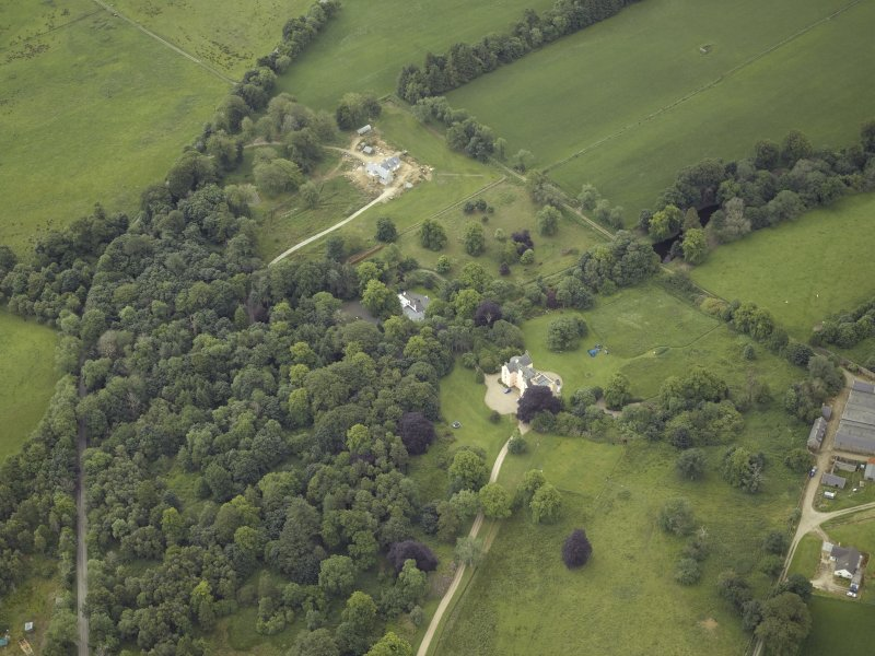 Oblique aerial view centred on the country house with the farmhouse adjacent, taken from the NW.