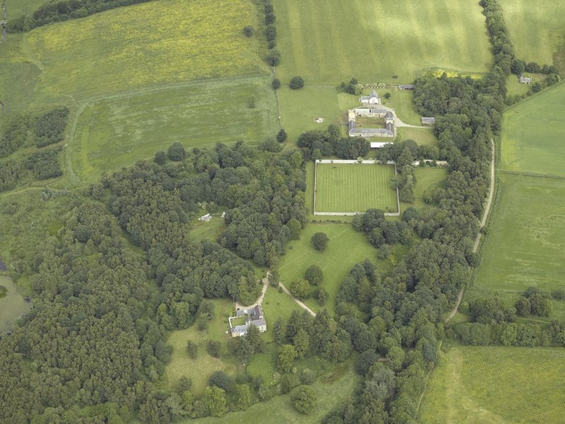 General oblique aerial view centred on the castle and walled garden with the farmhouse and farmsteading adjacent, taken from the S.