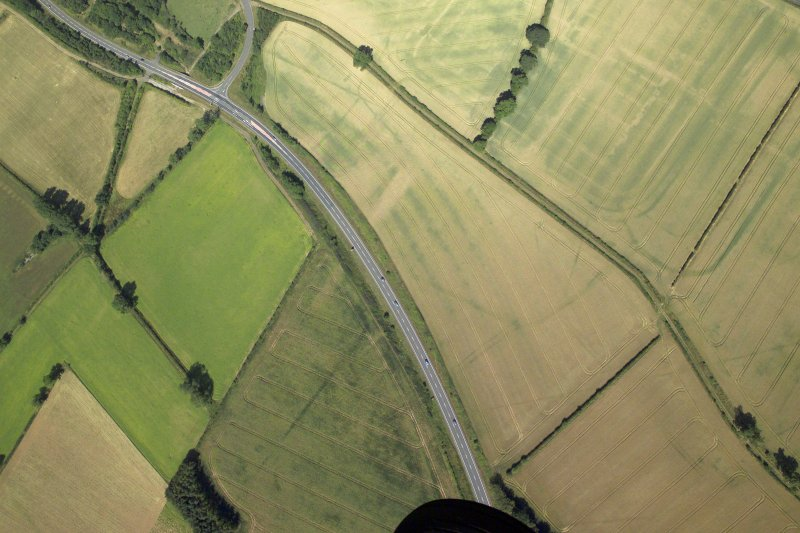 Oblique aerial view centred on the cropmarks of the possible fort annexe, taken from the SE.