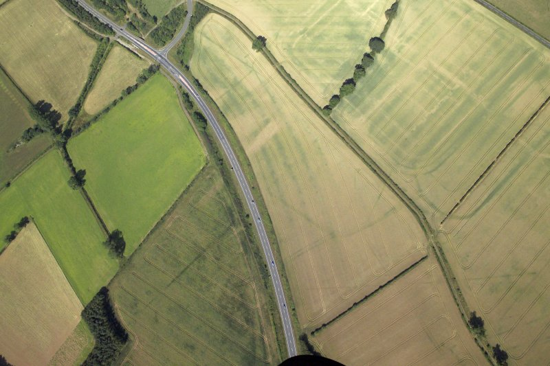 Oblique aerial view centred on the cropmarks of the possible fort annexe, taken from the ESE.