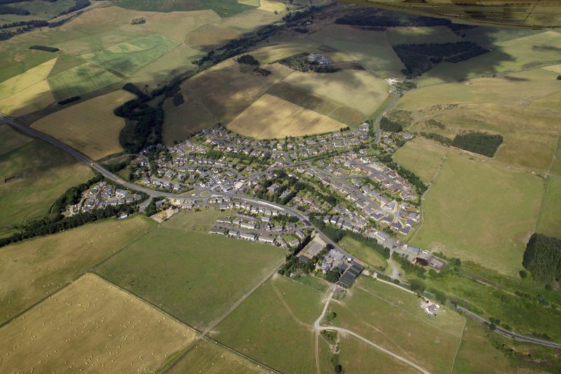 General oblique aerial view centred on the village, taken from the ESE.