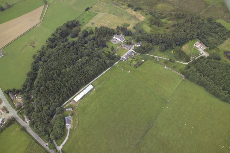 General oblique aerial view centred on the country house, taken from the ENE.