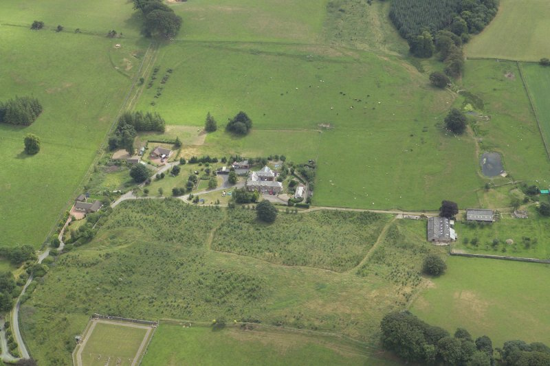 Oblique aerial view centred on the houses and the site of the house, taken from the WNW.
