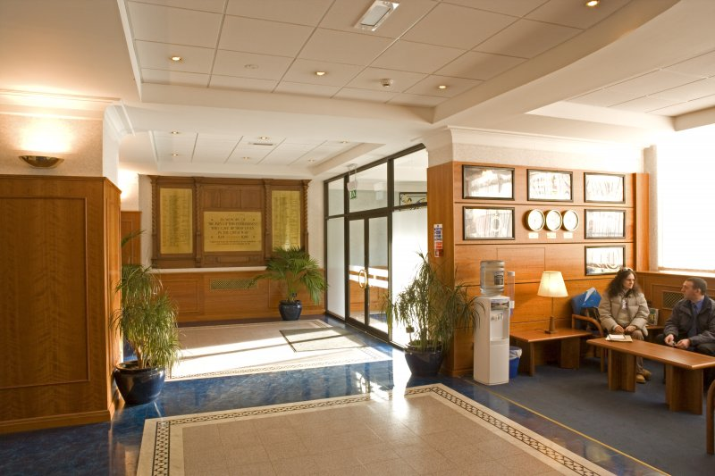 Interior. Reception area, ground floor. General view looking E towards company war memorial and main entrance.  The decor dates from 2001.