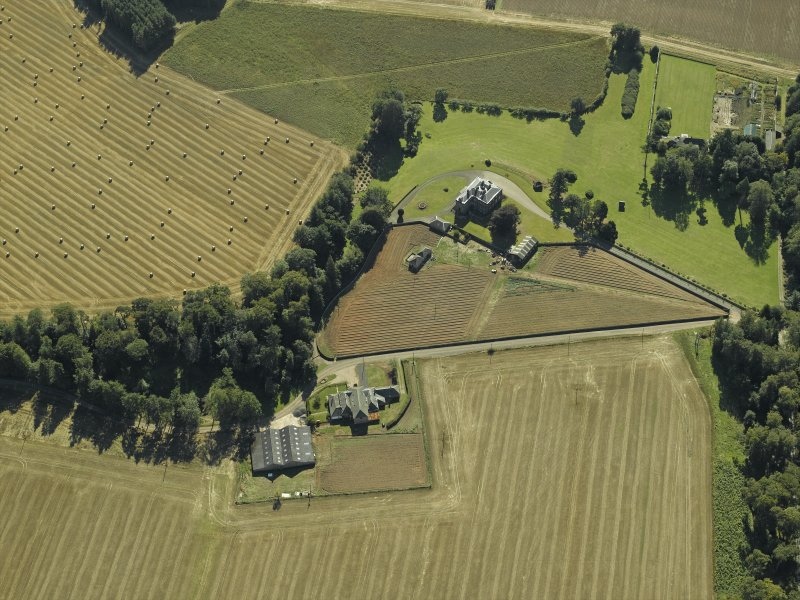 Oblique aerial view centred on the country house and walled garden, taken from the NNW.
