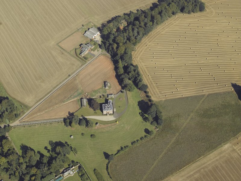 Oblique aerial view centred on the country house and walled garden, taken from the SSW.