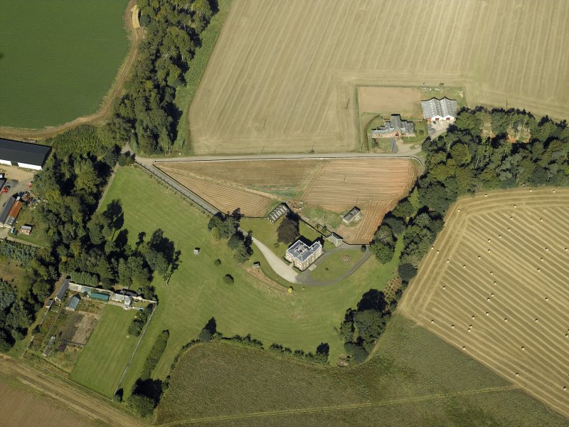Oblique aerial view centred on the country house and walled garden, taken from the SE.