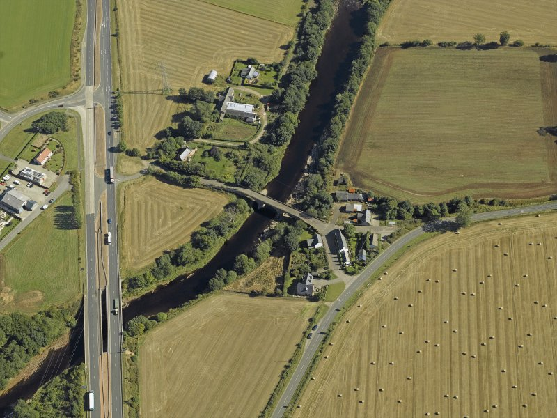 Oblique aerial view centred on the road bridges and tollhouse, taken from the SW.