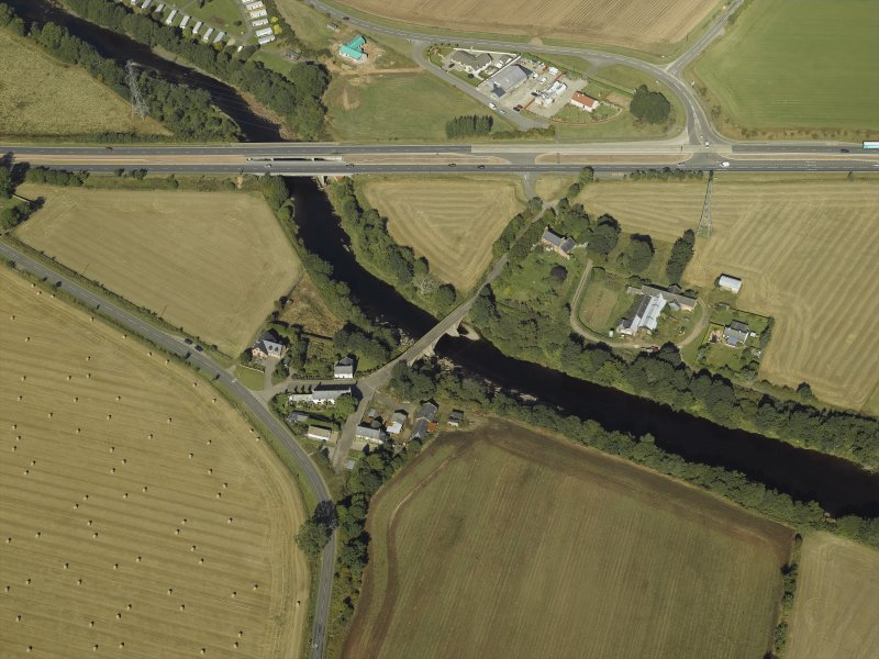 Oblique aerial view centred on the road bridges and tollhouse, taken from the SE.