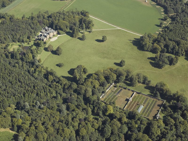 General oblique aerial view centred on the country house and walled garden, taken from the WSW.