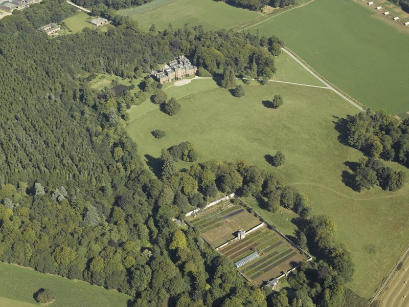 General oblique aerial view centred on the country house and walled garden, taken from the SW.