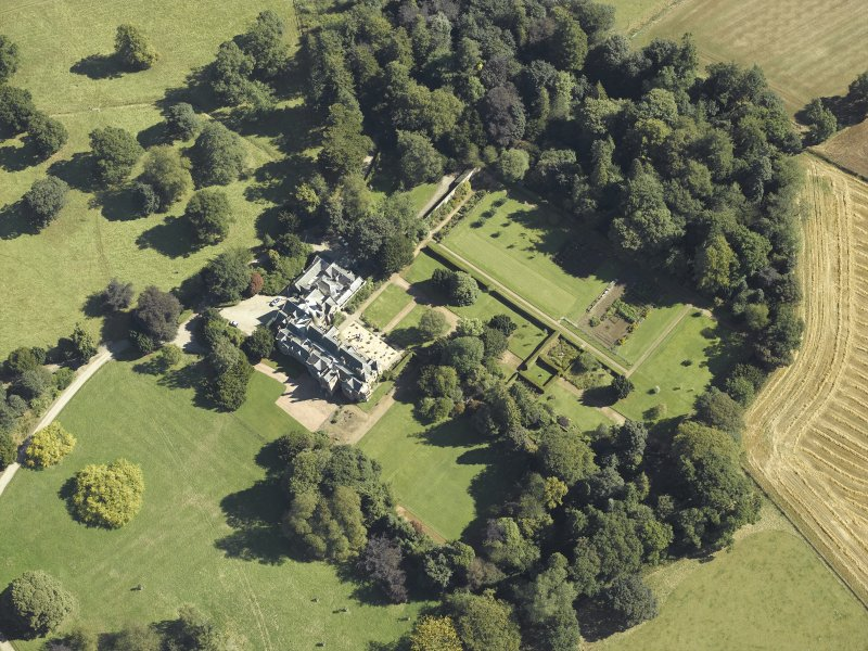 Oblique aerial view centred on the country house and gardens taken from the W.