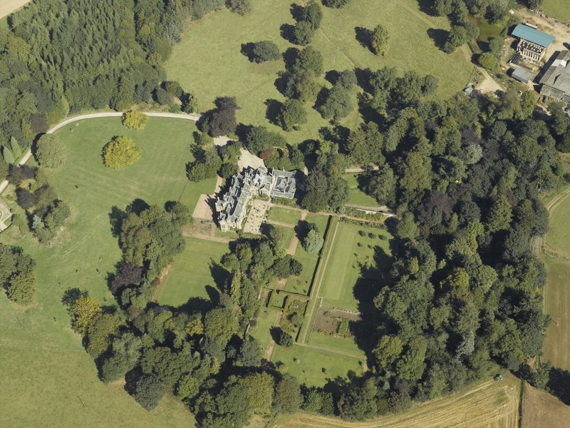 Oblique aerial view centred on the country house and gardens taken from the SW.