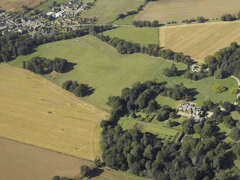 General oblique aerial view centred on the country house and gardens with the cottage adjacent, taken from the ESE.