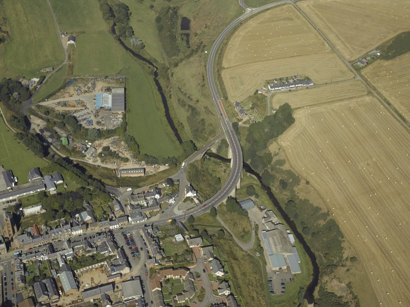 Oblique aerial view centred on the road bridges, taken from the SE.