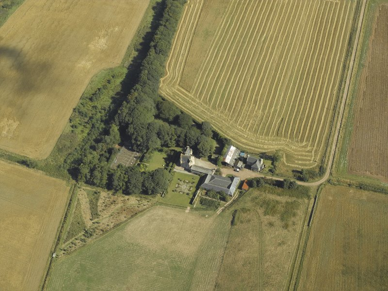 Oblique aerial view centred on the farmhouse, farmsteading and tower-house, taken from the SW.