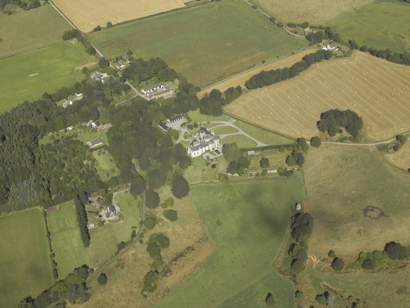General oblique aerial view centred on the country house, dovecot, summerhouse, gate-lodge and walled garden, taken from the SSE.