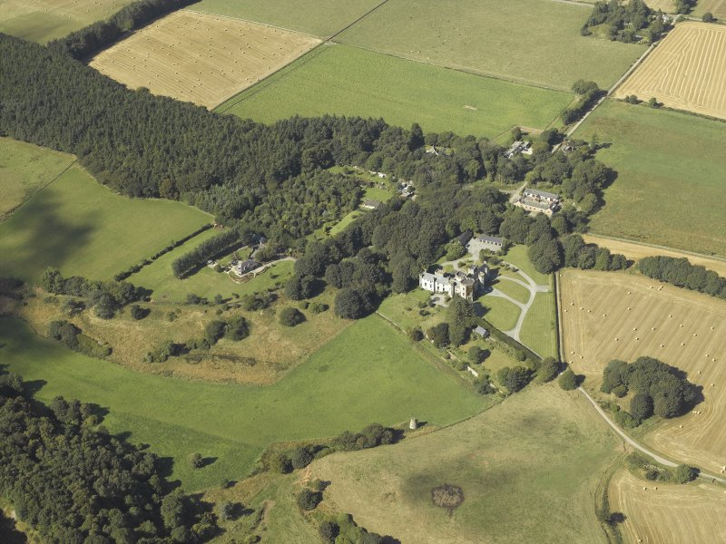 General oblique aerial view centred on the country house, dovecot, summerhouse, gate-lodge and walled garden, taken from the SE.